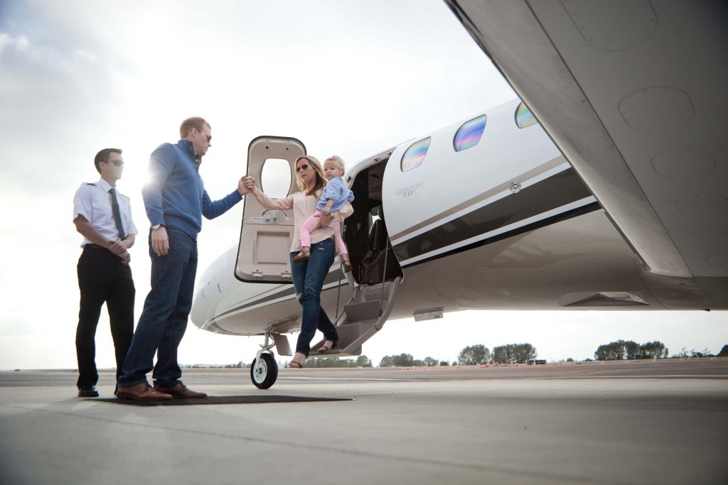 Latitude 33 Aviation Customers Getting Off A Private Jet