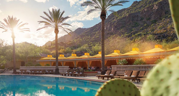 Private jet to Scottsdale to lay by the pool in a hotel with palm trees