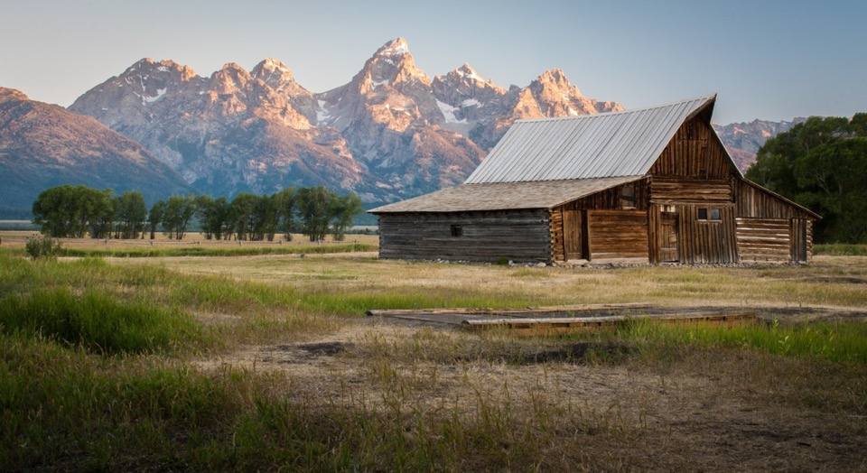 Countryside view with mountains and house in Jackson Hole Wyoming