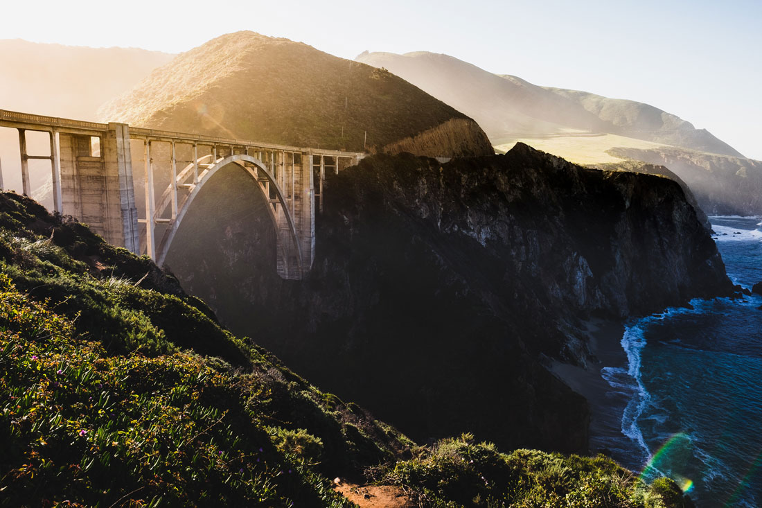 Private jet to Monterey to see a bridge above the ocean shoreline