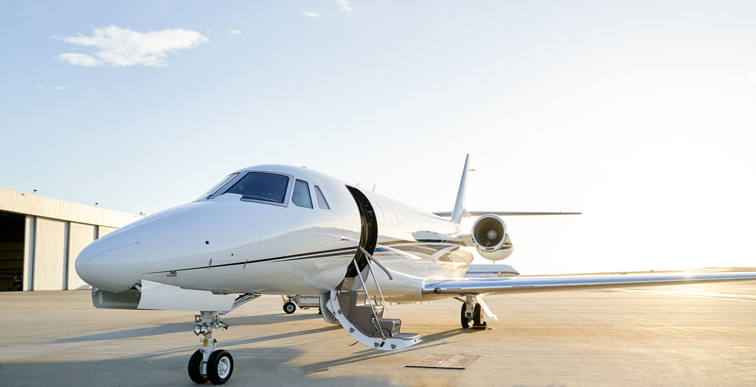 Scholarship for Latitude 33 Aviation's Citation Sovereign+ on airport ramp with door open