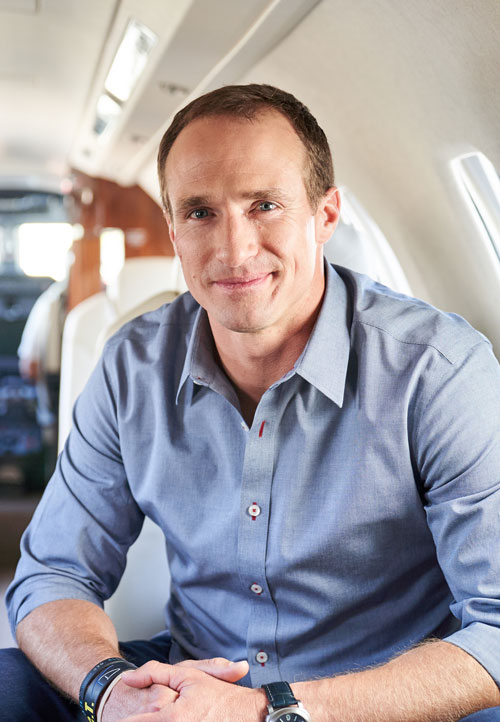 Drew Brees in Latitude 33 Aviation's private jet