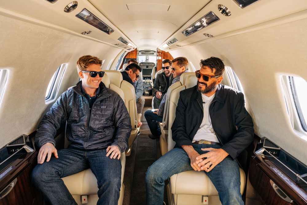 Men inside Latitude 33 Aviation private jet