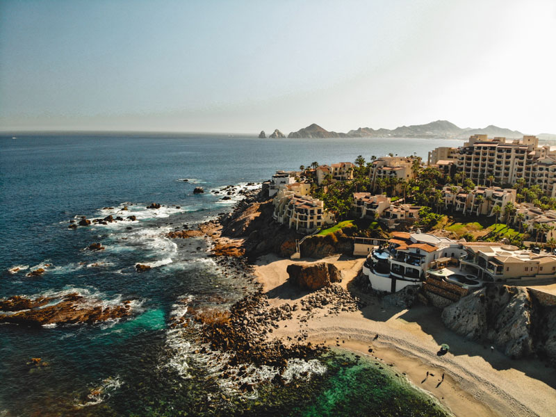 private jet to Cabo san Lucas to see an aerial view of a hotel on the beach shoreline