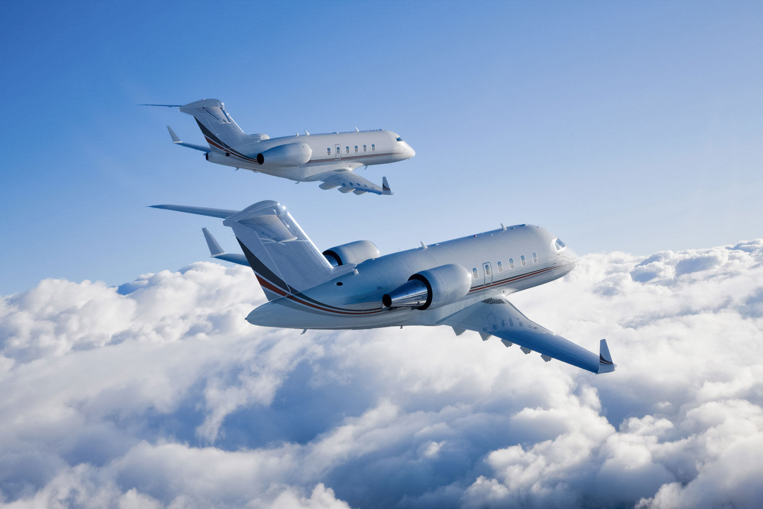 Bombardier Challenger 300 For Charter Aircraft Type Latitude 33 Aviation flying above the clouds