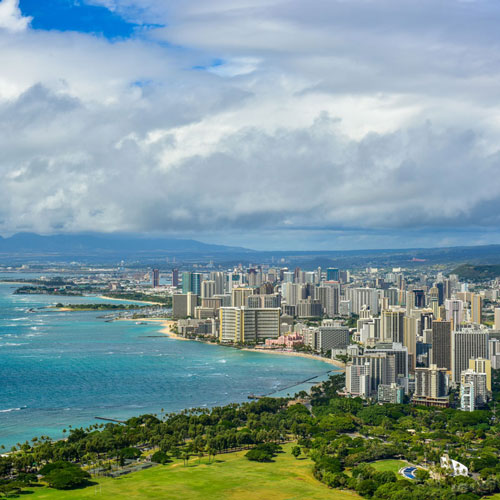 Private jet to view Honolulu's city view next to the ocean