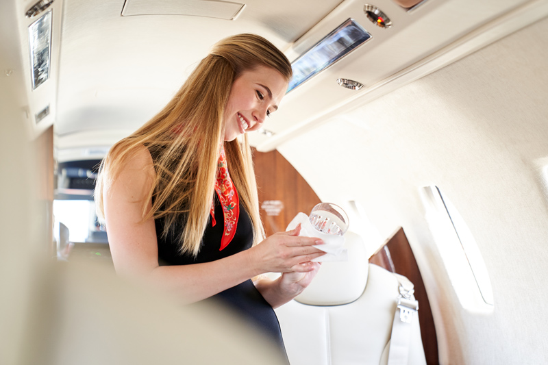Flight attendant of private jet with perfected cleaning methods and guidelines from Latitude 33 Aviation