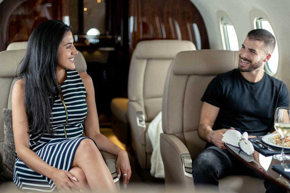 Top 5 Tips for Private Jet Travel this Summer with Latitude 33 Aviation - Man and Woman on Private Jet