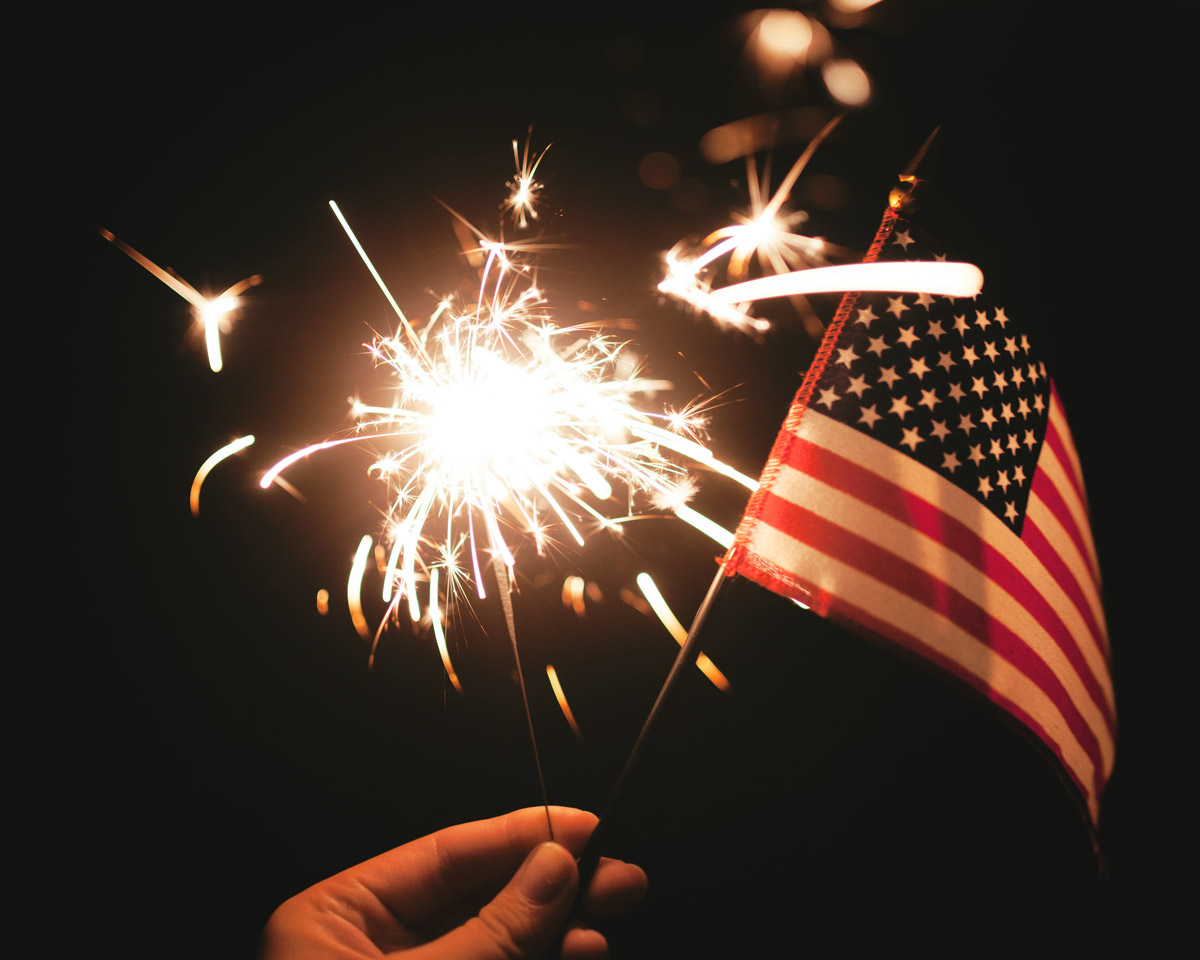Things to do in California for Fourth of July - American flag and sparkler