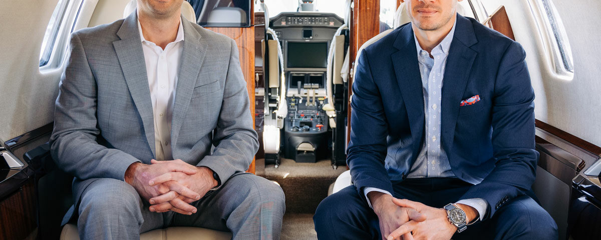 Latitude 33 Aviation Celebrates 15-Year Anniversary with Owners sitting inside aircraft